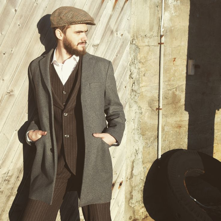 Oldschool suit with modern coat. Sixpence and a scruffy beard.