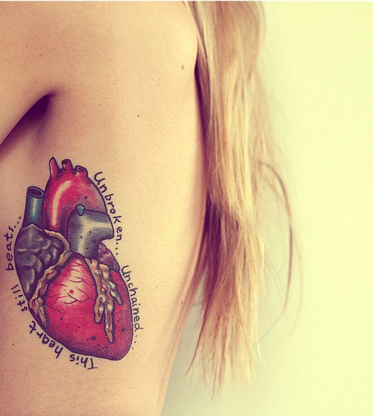 Real Heart Tattoo On Girl Side Rib