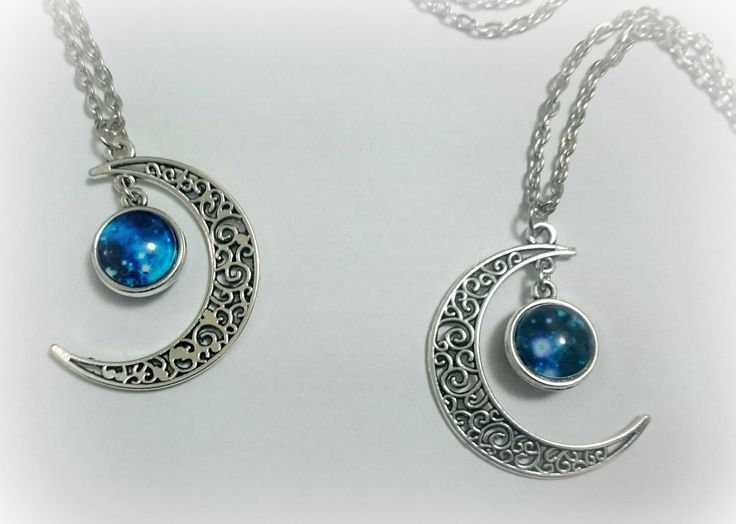 A reversible necklace, each side has a different nebula image set under a clear glass dome, swinging from an ornate silver crescent moon pendant. The moon measures 2 inches in length.Worn on a 20 inch nickel free silver chain with lobster clasp.