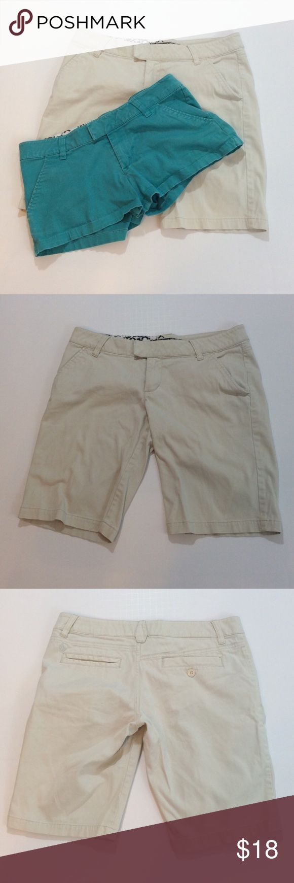 """2 pairs Volcom shorts size 3 2 pairs Volcom shorts size 3, both pairs have a waste of 26 a rise of  7 1/4""""and a 31 inch band.  The khaki shorts have a 10 1/2 inch inseam and the turquoise pants have a 2 1/4 inch inseam. Spring, summer Volcom Shorts"""