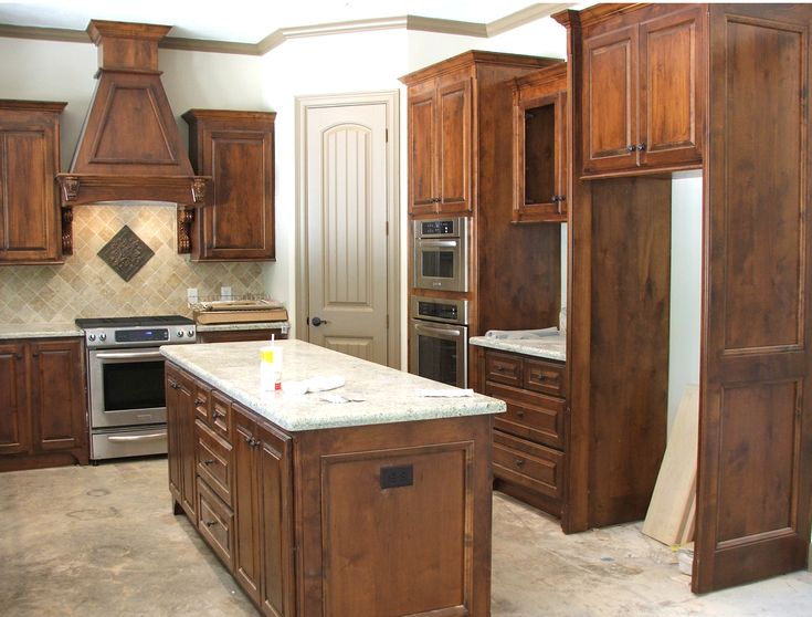 Knotty Painted And Stained Kitchen Cabinets