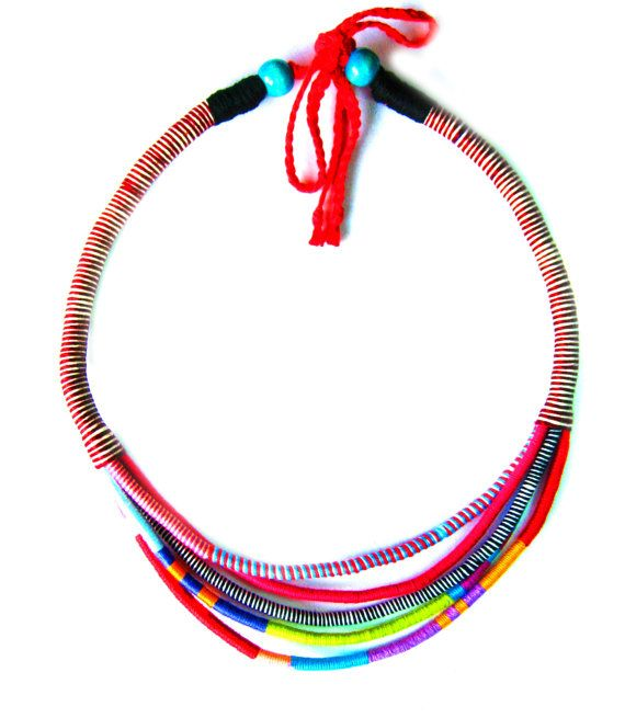 Jenny e Tribal Style Multi Strand African Necklace. The necklace contains five handmade cotton rope strands wihch are wrapped in tribal african style. Cord