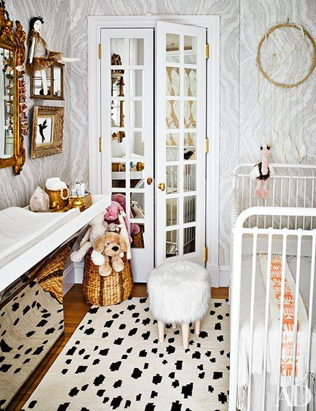 The nursery is clad in a wallpaper by Apparatus and Zak + Fox; the crib is by RH Baby