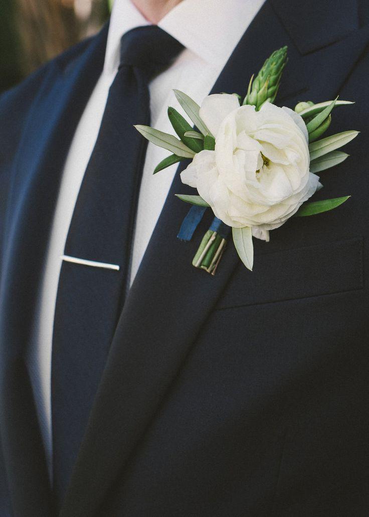 white ranunculus boutonniere | photo: Emily Blake