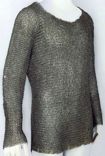 European riveted mail hauberk, late 15th century. Low-carbon steel, hardened by quenching after construction, and copper alloy. Length: 71.1 cm, front. Length: 76.2 cm, back. Diameter: 1.07 cm, links. Weight: 7.485 kg, The Wallace Collection, (Wallace A6).