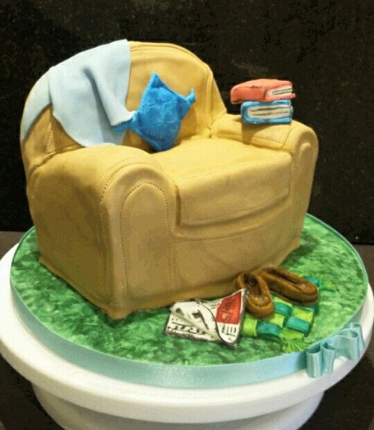 Birthday cake, fathers day, retirement. Dads chair with edible decorations, slippers, news paper, cushion and books. By Danielle Smith ( Rockylicious Cakes )