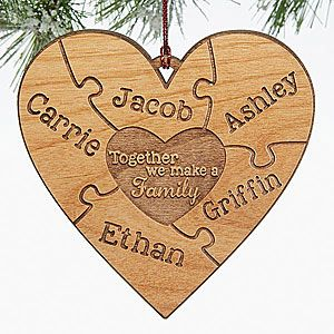 "This engraved wood heart puzzle ornament is beautiful! LOVE the heart puzzle piece design! You can add every family member's name and the middle says ""Together we make a family"" - great ornament for blended families too!"