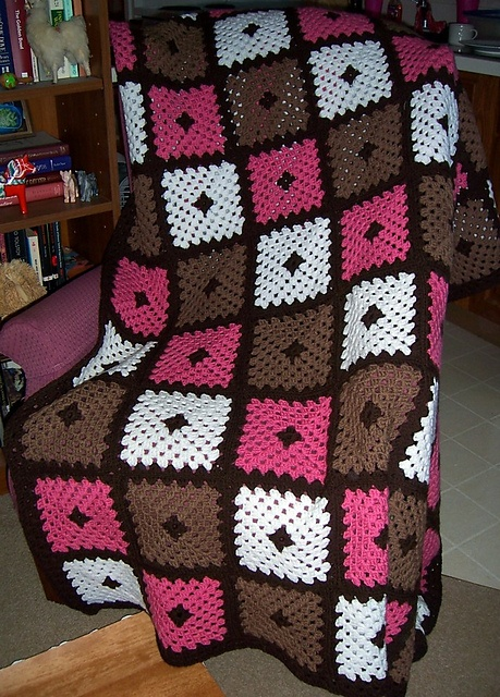 Granny square afghan I made from browns, pink and white