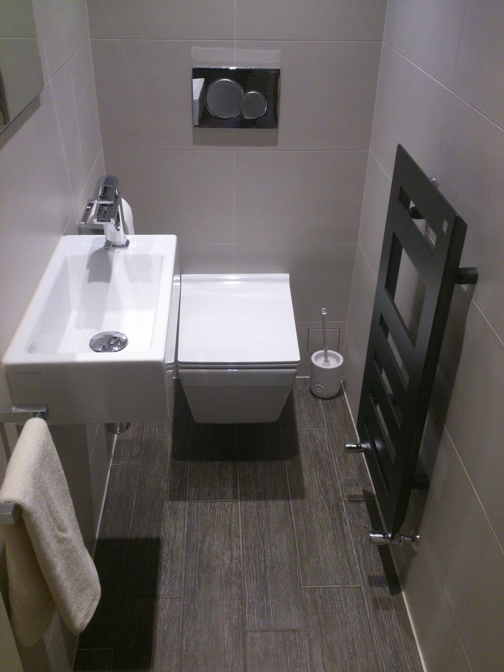 Cloakroom with designer tile modern zehnder radiator for Toilet bathroom design