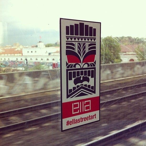 Tiki by #ellastreetart.  Sticker on train in Rome Testaccio.