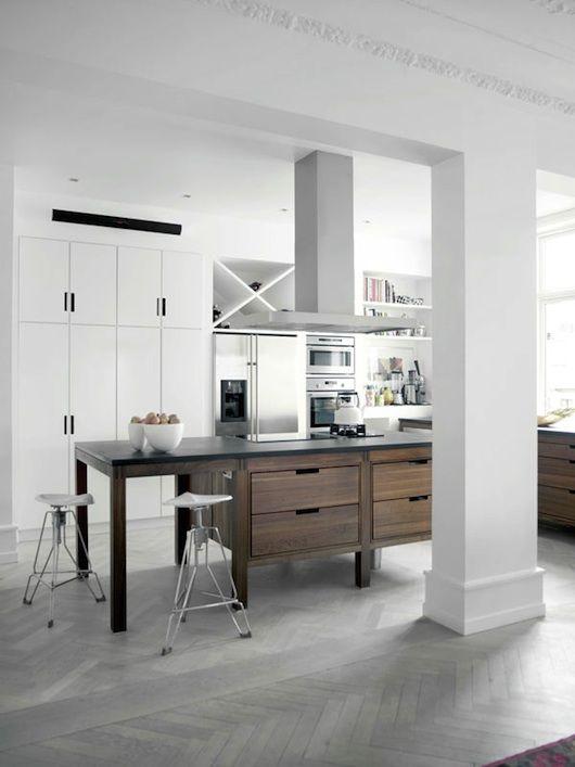 cocina abierta en vivienda isla central con zona de coccin y pequea barra