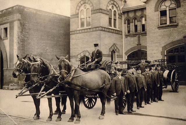 Toronto Fire Dept. Yorkville Ladder Company, 1915 Station 10's ladder crew poses by their apparatus in October, 1915