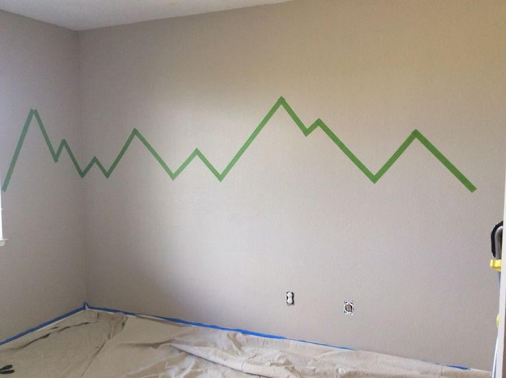 Wall all painted in Malibu beige. Prepped the accent wall with froggy tape (best one) getting the angles right for the mountains takes some time and a large ruler if you want them to be precise