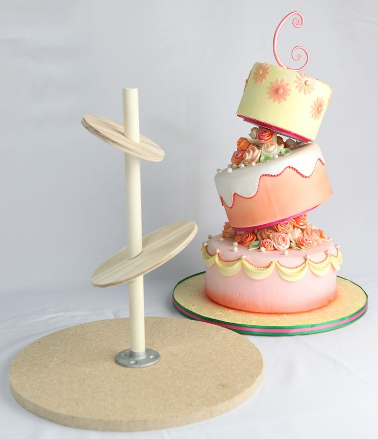Every cake needs a structure to make sure it doesn't move or fall over. Building your structure is the first step in designing your cake because like this cake, you have to add the slanted structure before putting the cake together.