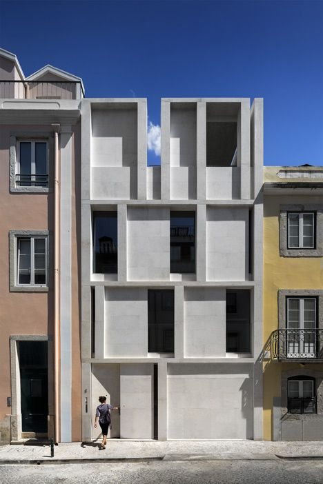 Slotted in amongst a row of traditional Lisbon townhouses, this five-storey residence was designed by local studio ARX Portugal with the same tall and narrow proportions as its neighbours.