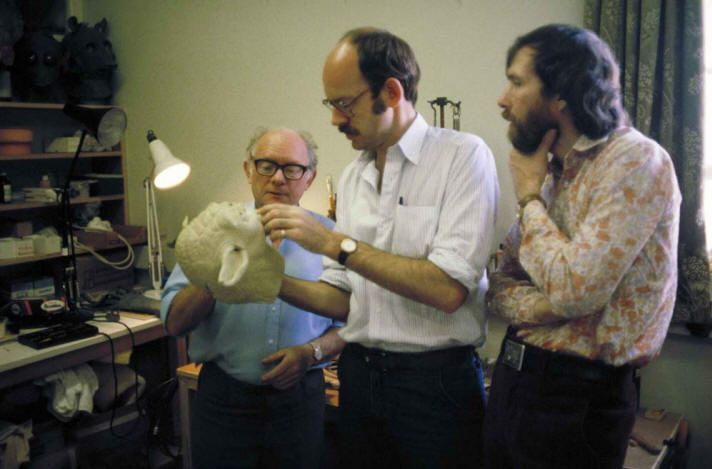 The muppet's masters inspecting Yoda's head.