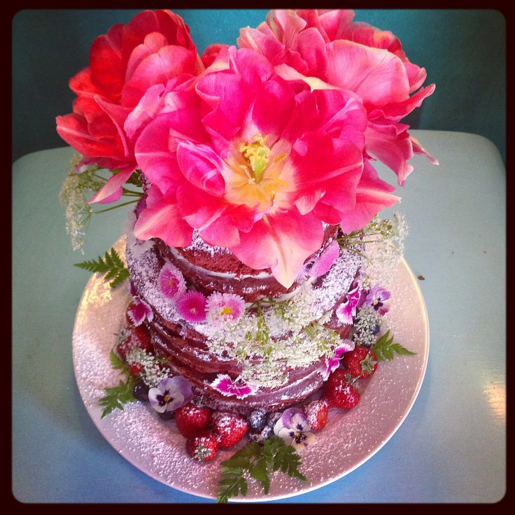 naked cake with edible tulips on top, seasonal edible flowers and sweet cicely to decorate, all available from greensofdevon.com