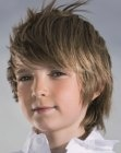 Grown out look for boys. No too short style for easy to maintain hair. More haircuts for boys: http://www.hairfinder.com/kidshairstyles/hairstyles_for_boys.htm