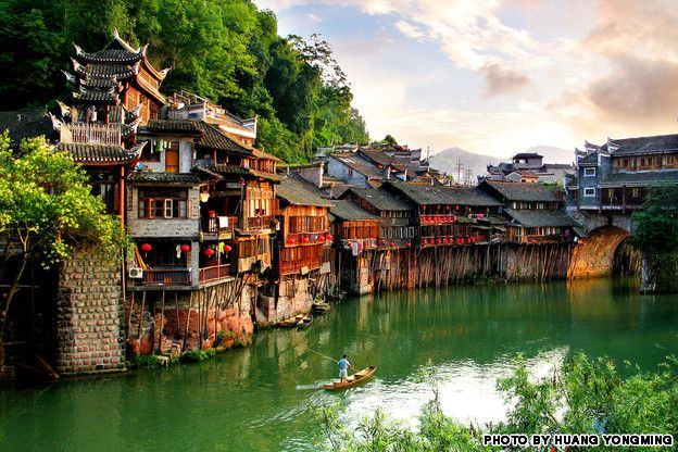 """Every year, armies of young backpackers flock to the ancient town of Fenghuang (which literally means """"Phoenix"""") for its rich Miao and Tujia ethnic culture. These stilted houses are the dream lodgings of Chinese art and literature lovers."""