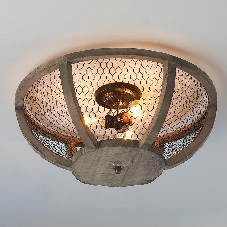 Chicken Wire Basket Ceiling Light Mesh wire wraps around a distressed wood  frame for a country