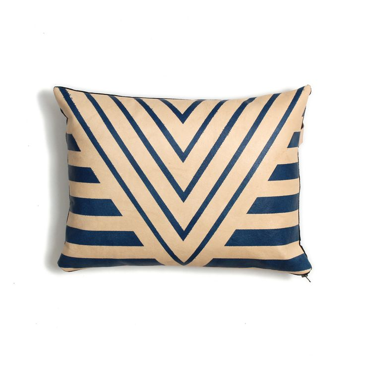 The Painted Plains collection utilizes cowhides and bold graphics to create  a modern juxtaposition between material and pattern. Every pillow design is  hand-painted in Brooklyn and sewn with skilled craftsman in New York.  The  reverse features a black yarn-dye linen and signature logo handle. We love  the character a product acquires when it is hand made. Every unique mark  and paint line is what makes it special and they will vary slightly on each  item. These pillows are meant to…