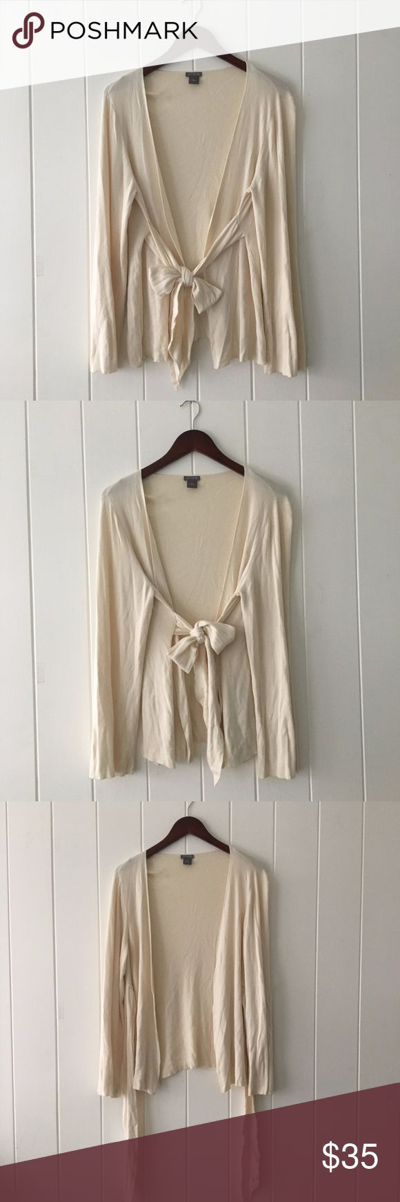 Ann Taylor Cream Bow Tie-Front Cardigan Sweater Super cute and soft cardigan Light cream color Long Sleeve Cardigan Tie Front Bow Small spots shown in last photo Ann Taylor Sweaters Cardigans