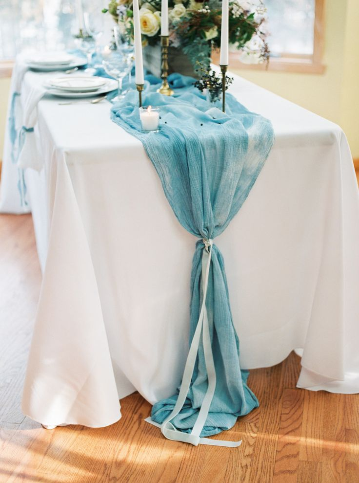Hand dyed blue runner . Photography: Jake Anderson - jakeandersonphoto.com/  Read More: http://www.stylemepretty.com/2015/03/01/midwest-snowy-bridal-session/