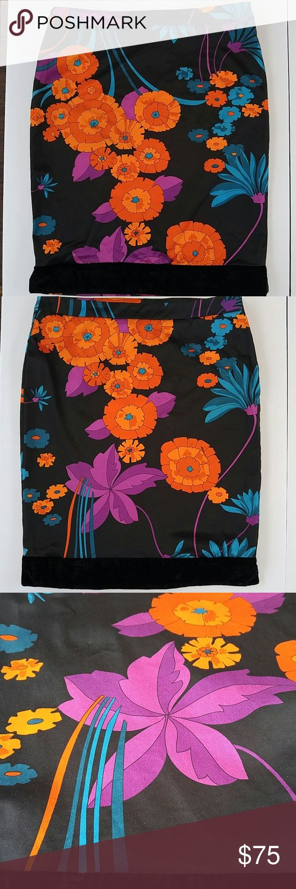 "Dolce & Gabbana Floral Skirt with Velvet Trim Authentic D&G black skirt with stunning orange, violet, and blue flowers. Black velvet trim. Side zipper. Price drastically adjusted due to a pinhead size pull and short streak of black marker? on orange flower - find in pic. I haven't tried to remove but the skirt is actually washable! Just iron inside out. Approx. 19.5"" long. 14.5"" flat waist. Dolce & Gabbana Skirts"
