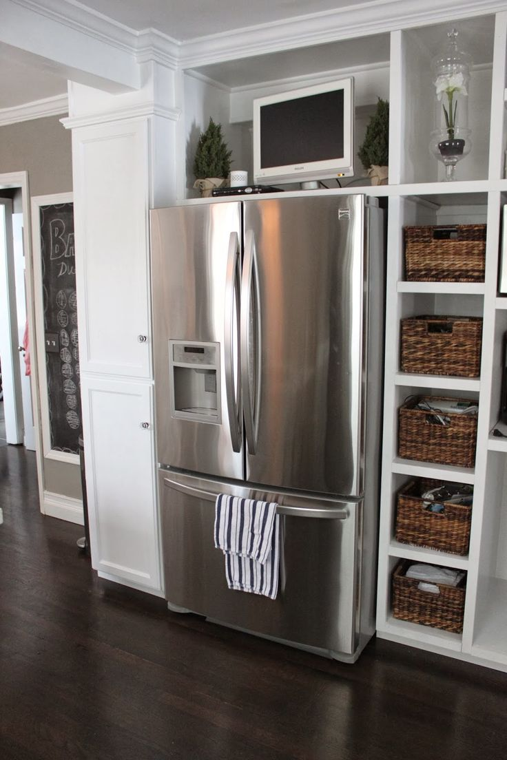 top 25 best tv in kitchen ideas on pinterest a tv built in just like my kitchen fridge next to load bearing beam enclose the fridge in cabinetry or go with the open shelves
