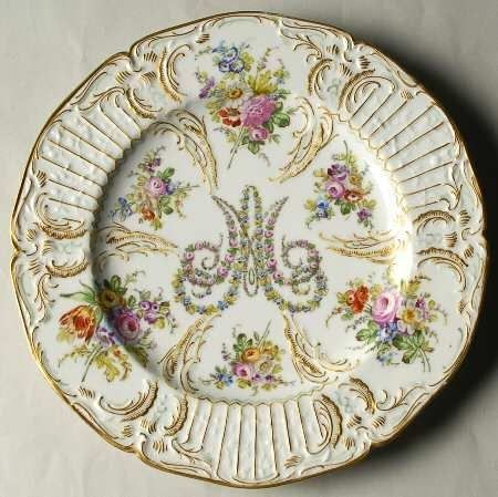 A plate with Marie-Antoinette's monogram .
