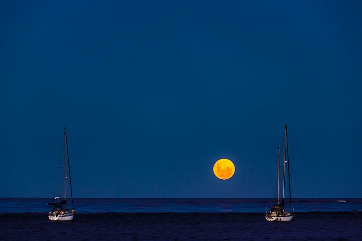 Moonrise With Two Boats