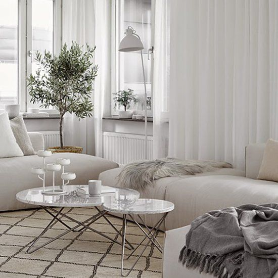 I'm always fascinated by how cozy and warm an all white apartment can be (image via Hitta Hem)