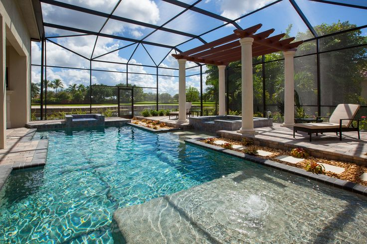 Swimming pool at Emerald Homes Mirabella Model at Palmira Golf and Country Club, Bonita Springs FL. Interior Design by Janet Graham Baer's Naples and Connie Sherrard Baer's Ft. Myers