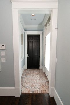 One of our many beautiful hallways, featuring custom herringbone brick flooring. Check us out for your Houston area custom home building needs! http://www.customhomesbuilderhouston.com/