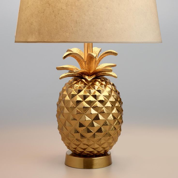 We're captivated by the intricate details of our pineapple accent lamp that recreate the fruit's geometric texture and iconic top. Crafted of metal with a shining brass finish, this fun World Market exclusive symbolizes welcome and hospitality.