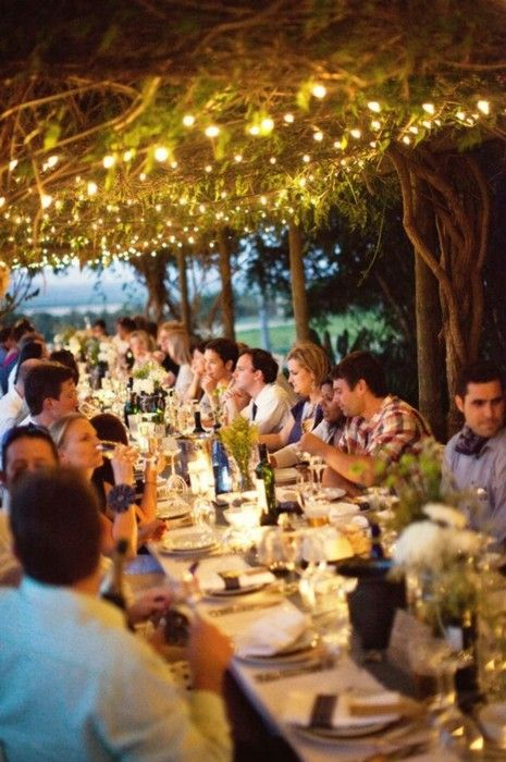 I want to host parties like this. Outdoors on a summer night, twinkle lights, lots of food, and people you love.