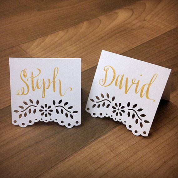 Personalize your event with these custom hand-written calligraphy tent-fold place cards with a simple, chic, lace floral vine design.