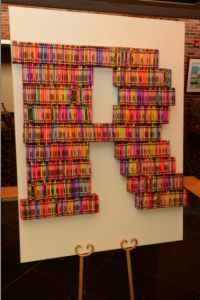 Here's a creative centerpiece idea for an artistic bar or bat mitzvah. I wonder how many boxes of crayons this took to build.