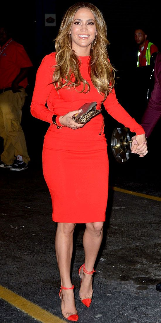 WOW! Jennifer Lopez celebrates her 43rd birthday in red hot sheath by Tom Ford, a metallic Fendi clutch and cap-toe Louboutins.