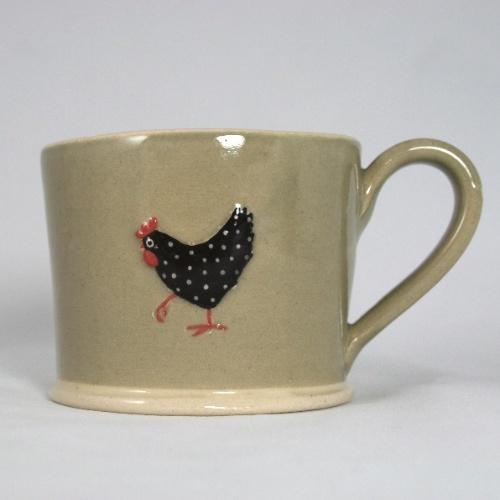 Jane Hogben hen mug on charcoal
