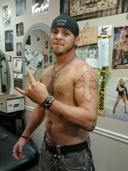 Brantley Gilbert shirtless showing off his tattoo