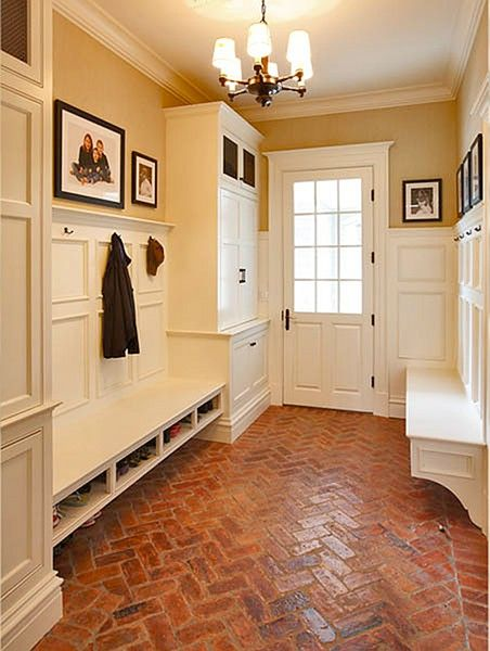 white and beige entryway; organized foyer; moulding as architectural detail, chevron floor pattern