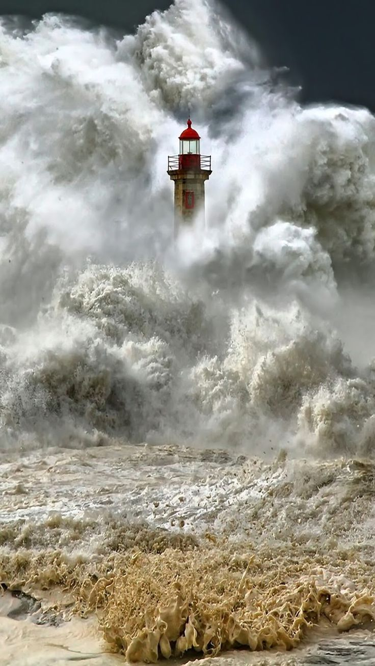 Porto, Portugal- Massive wave! It's amazing the lighthouse can withstand the water power...