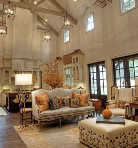 barn interior, french rustic, hanging lights, added gothic windows, wood floors, french doors