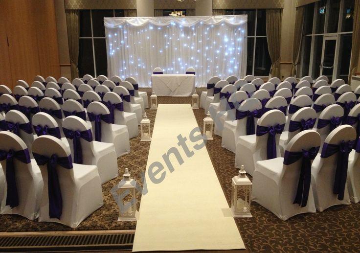Craxton wood wedding, cadburys purple sashes, cream aisle runner, lanterns and backdrop