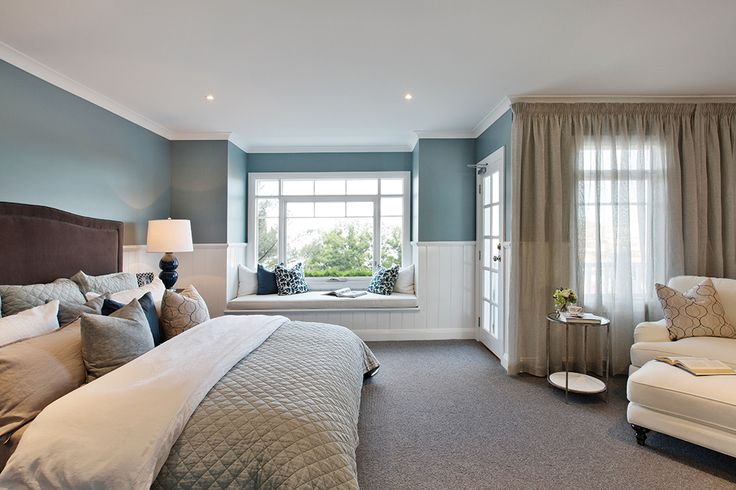 Luxurious master bedroom with Classic Hamptons World of Style on display in the Astor Grange.