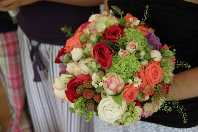 David Austin Roses Darcy, fresh fragrant Lily of the Valley, Fresh Blackberries, Hydrangeas, Viburnum Opulus, Rosemary, Peppermint, Eucalyptus and Alchemilla Mollis, the vivid shades of Raspberry, Lavender, Lime Green and Ivory