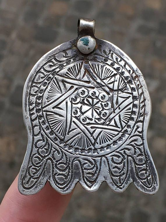 Star Hand of G--, Hamsa Charm, Khomsa, Judaica Pendant Moroccan Berber Antique 19th Century Solid Silver Hanukkah Gift This beautiful antique Hamsa Charm is beautifully decorated with a floral motif and made of at least 800/1000 solid silver. The Hand of G-- is a celebrated symbol for both Sephardic and North African Jews. This type of Hamsa is typically Moroccan. Jewish silversmiths produced much of the silver for both Muslim and Jewish communities at that time, and these components we...