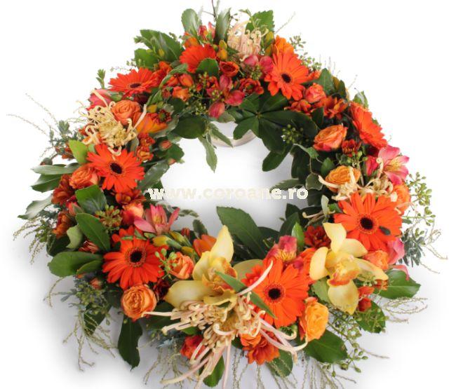 Coroana funerara autumnala realizata din flori proaspete in ton cu acest melancolic anotimp, numit toamna. Coroana este realizata din crizanteme, gerbera, trandafiri, alstroemeria, orhidee imperiala si un mix de verdeata premium pentru cel mai special omagiu!