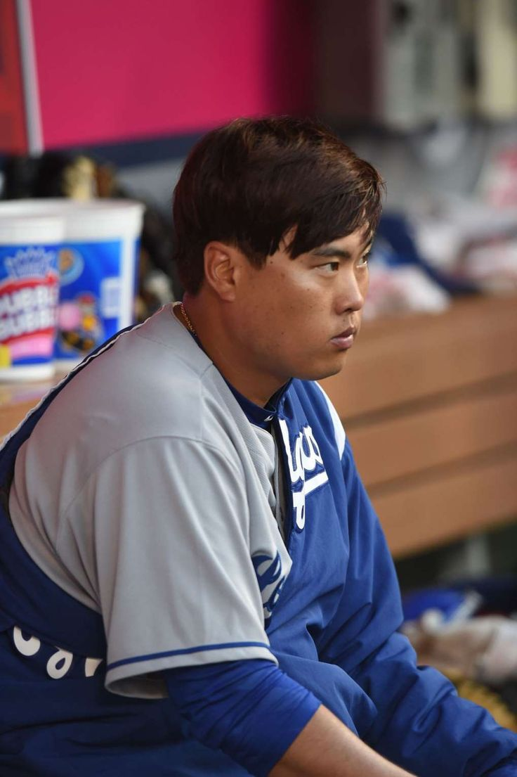 Dodgers' Ryu heads to DL with bothersome left foot  -  July 4, 2017:      Dodgers pitcher Hyun-Jin Ryu sits in the dugout between innings during a June 28 game between the Dodgers and Angels.